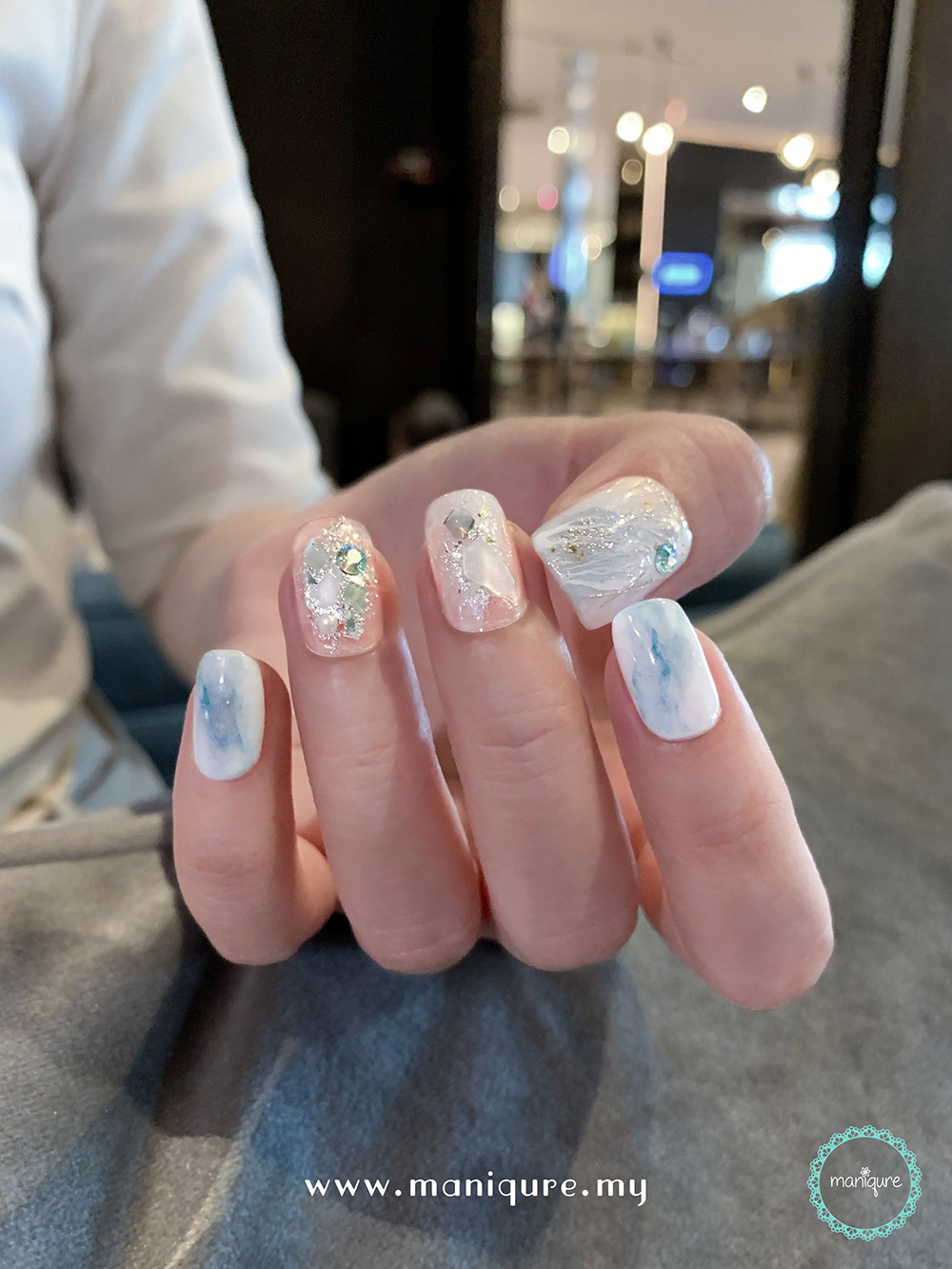 Enceladus Marble Nails – Saturn's Moon Manicure